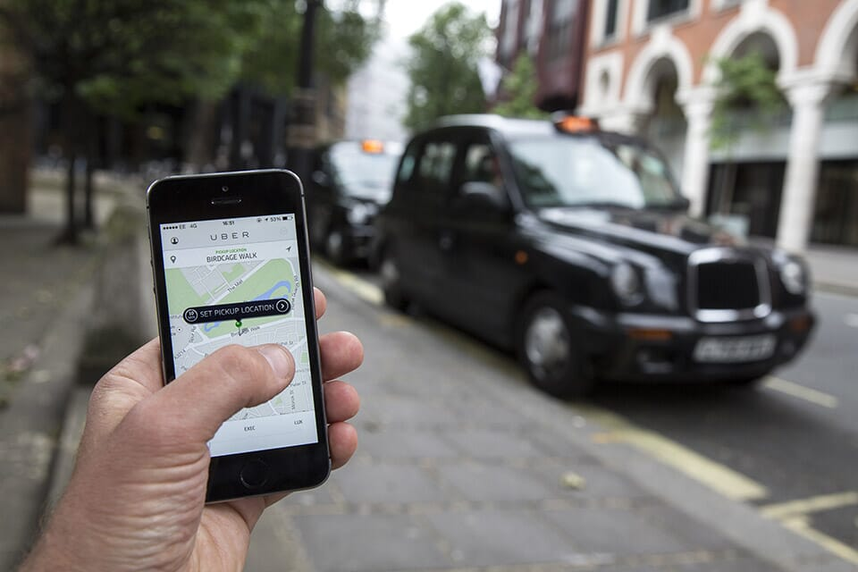Uber app being used to order a taxi